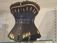 This corset from c.1900 has lacing down both sides and the back and fitted with 28 strips of whalebone. It was patented as having advantages for riding and golfing.