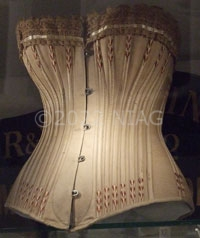 A wasp-waist corset made from khaki coutil from c.1890