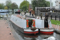 two boats leaving the lock into the Erewash Canal at Trent Lock