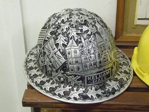 An oil worker's helmet from the 1940s bearing the picture and name of Kelham Hall
